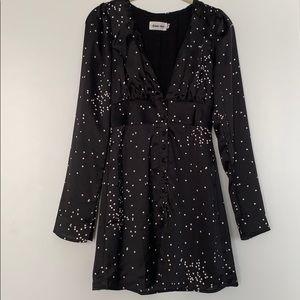 Black mini dress with white polka dots